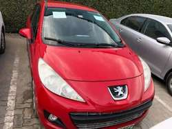 Here we are selling a red Peugeot 207